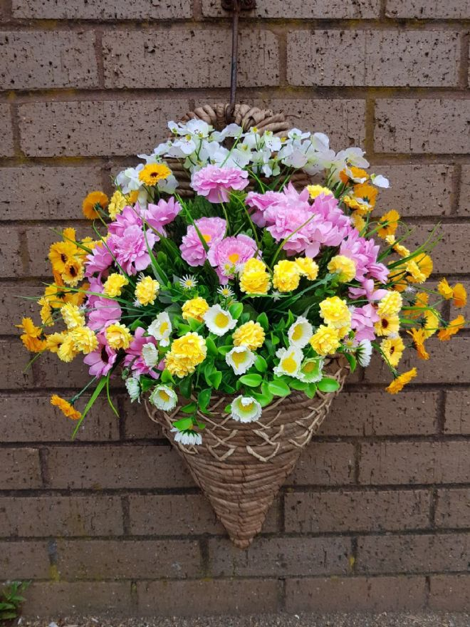 Wall mounted Pink, Yellow & White artificial flowers